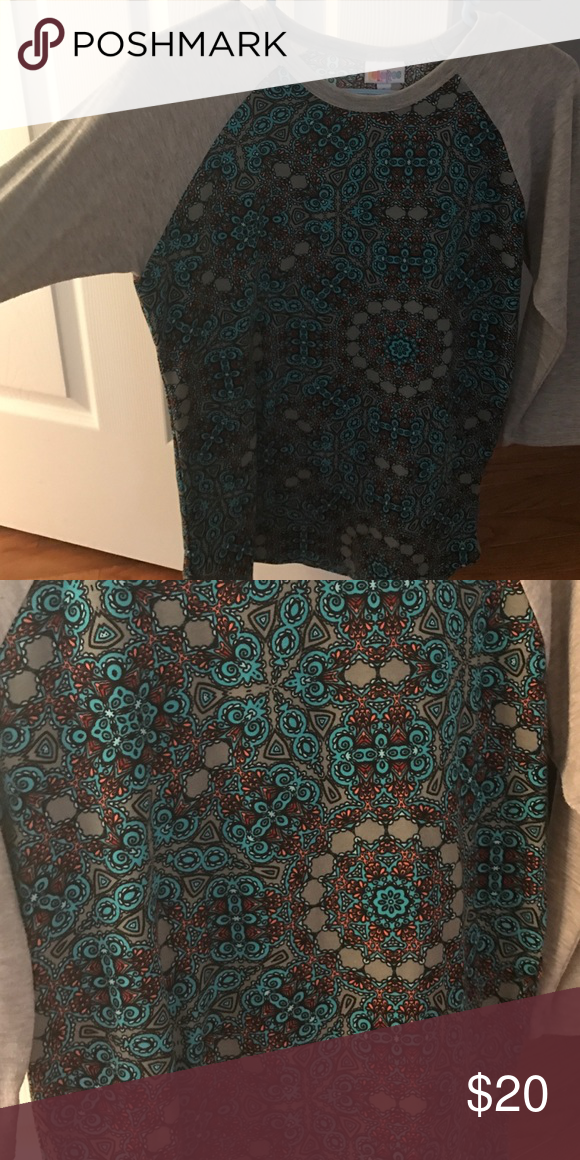 LuLaRoe Small Randy LLR Small Randy. Worn a handful of times and washed per LLR standards. Excellent condition. LuLaRoe Tops