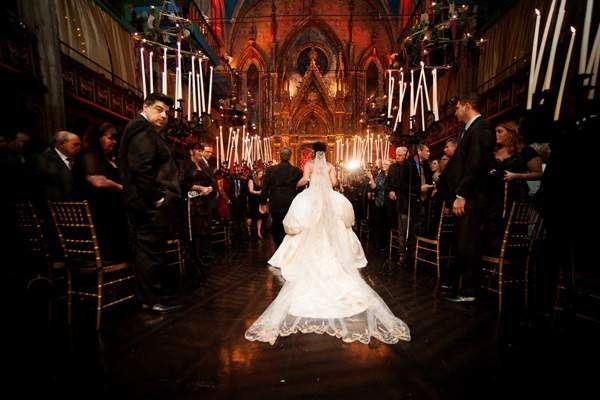 Halloween wedding in cathedral with candlelight