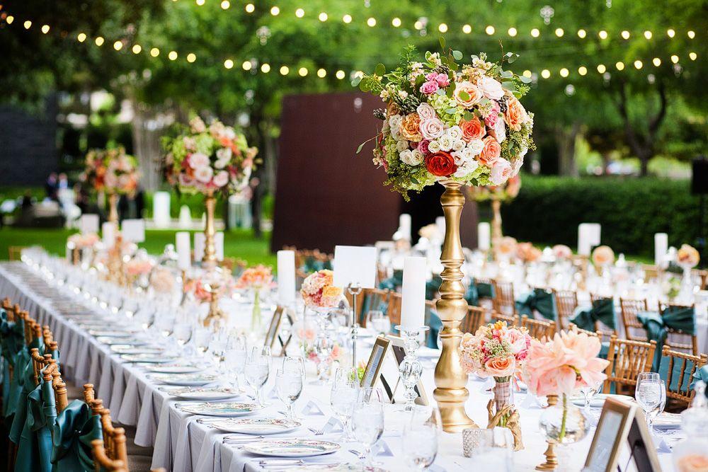 Long banquet tables with lush rose centerpieces // Allison Davis Photography