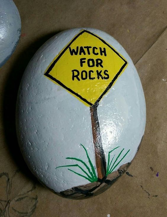 Watch For Rocks Sign Painted On A Rock
