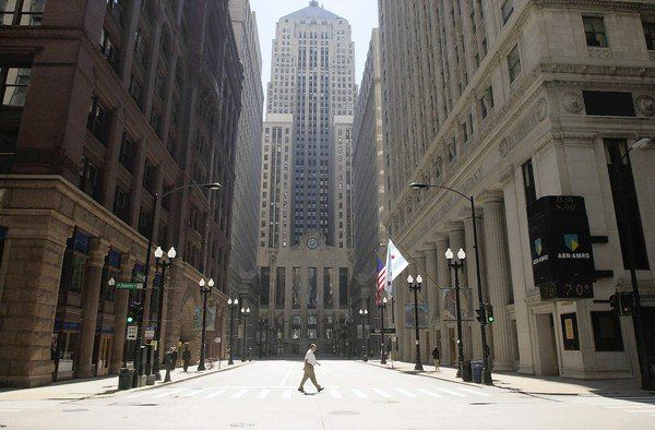 IN LOVE: CHICAGO... // Deserted district: Looking south toward the Chicago Board of Trade building on Sept. 11, LaSalle Street is nearly empty after banks and exchanges closed. When the markets reopened on Sept. 17, the Dow Jones industrial average plunged 684 points, the largest point drop in history but not the largest percent decline.