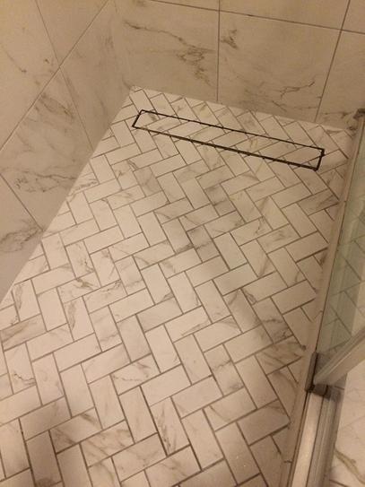 Marazzi Developed By Nature Calacatta 12 In X 14 In X 6 Mm Glazed Ceramic Herringbone Mosaic Herringbone Mosaic Tile Brown Tile Bathroom Diy Bathroom Remodel