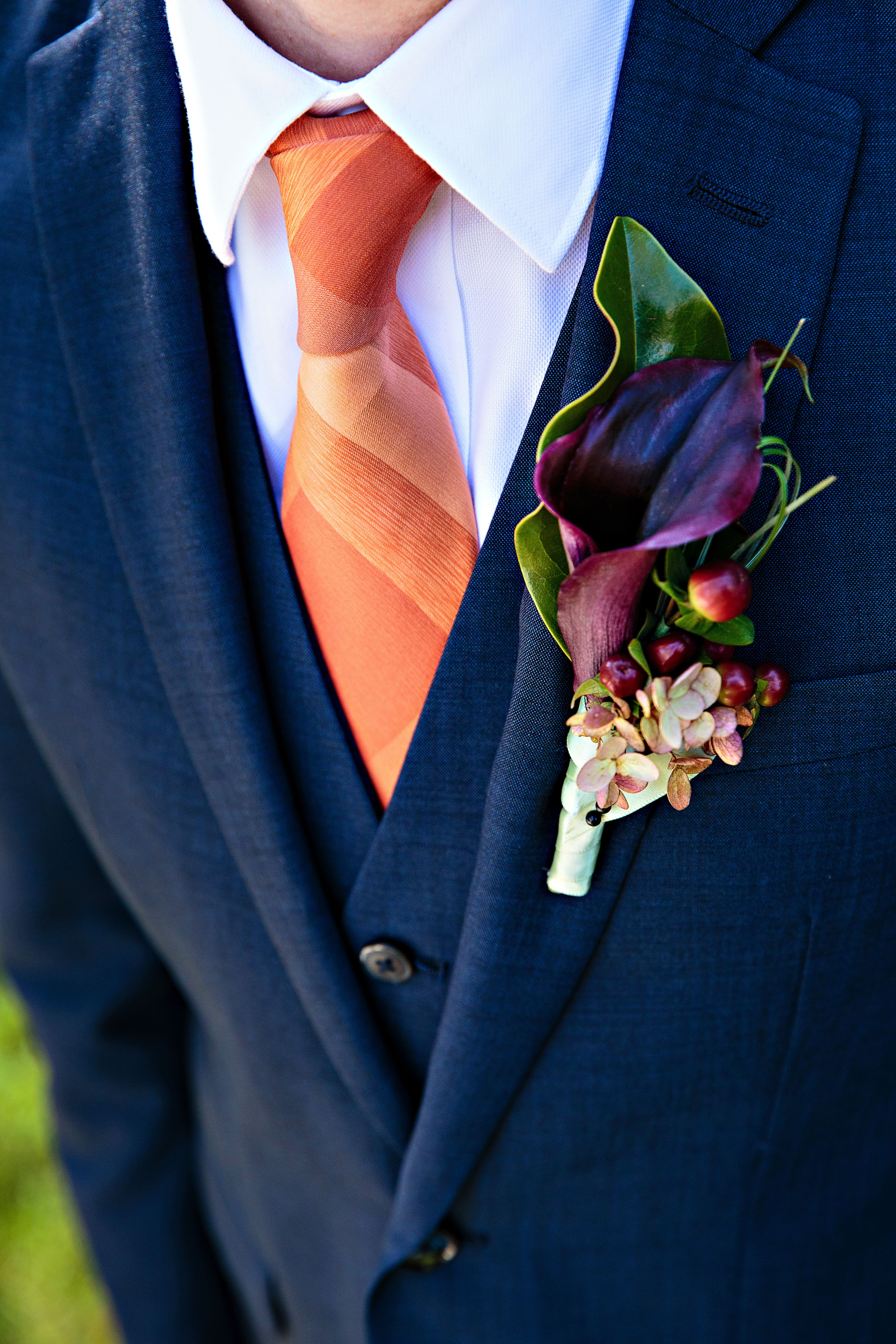 orange tie and purple cala lily boutonniere wedding