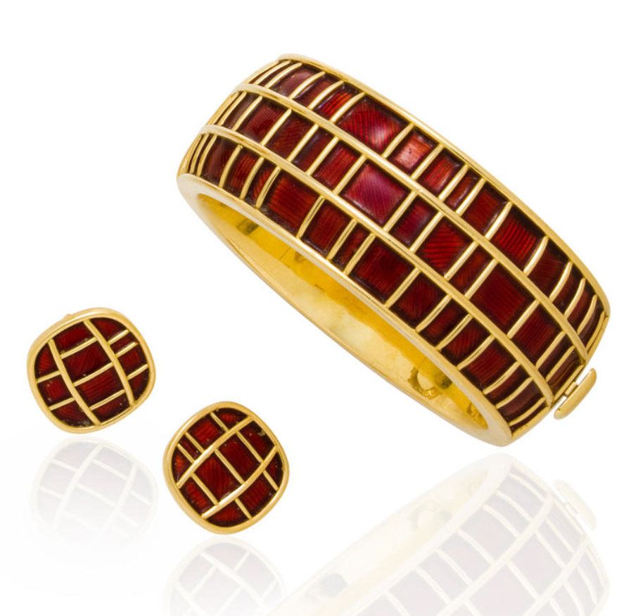 An eighteen karat gold and enamel bangle bracelet and earclips, De Vroomen, London, 1987 the hinged form designed with panels of contrast patterned dark red basse taille enamel, cushion-form earclips en suite; both signed de Vroomen, with British hallmarks; gross weight approximately: 195.6 grams; diameter: 2 3/8in.