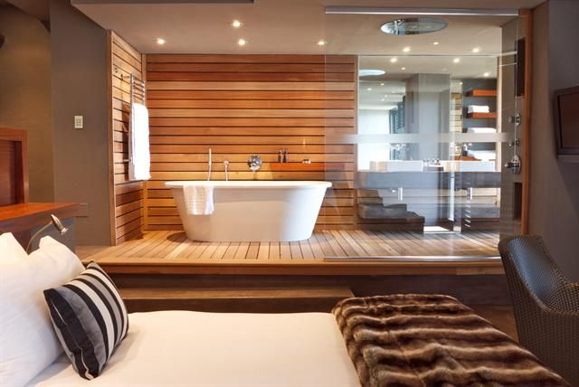Raised bath composition and materials bring outside in for Beautiful master bedrooms and bathrooms