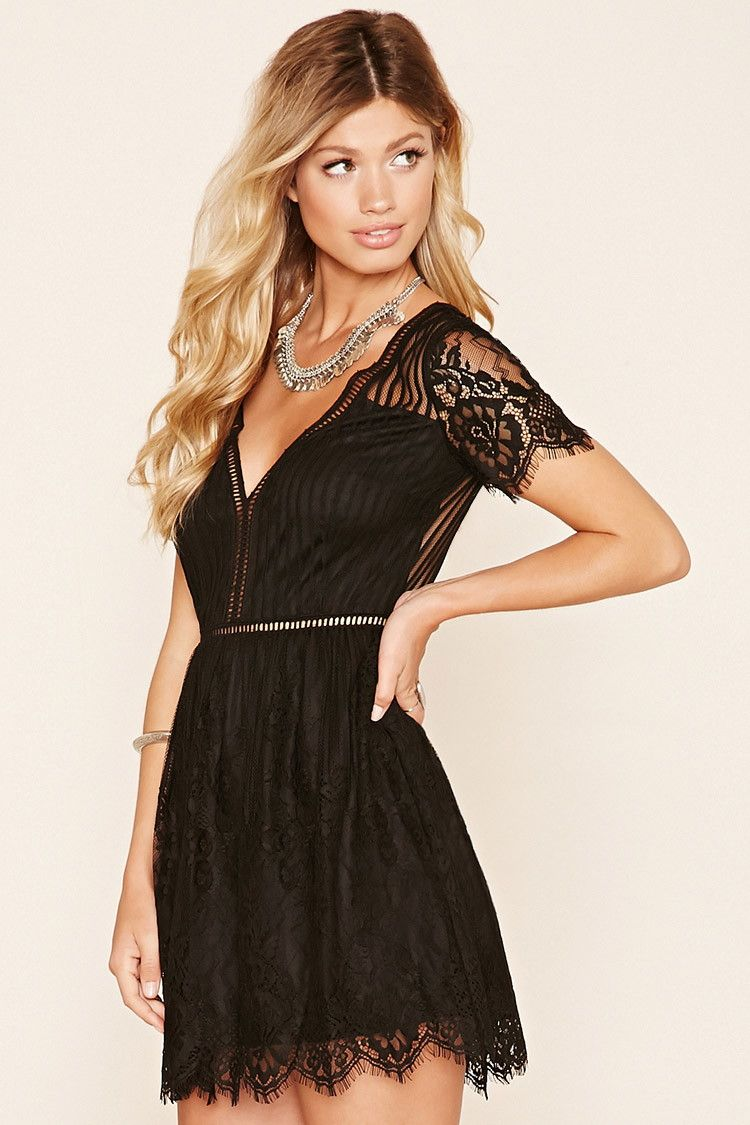 A floral lace mini dress featuring a striped pattern a sheer back