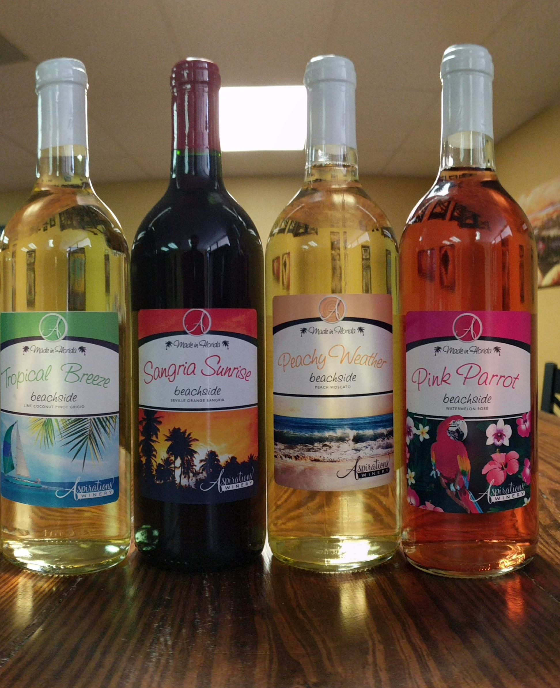 This is our beachside collection of wines tropical breeze sangria sunrise peachy weather and pink parrot
