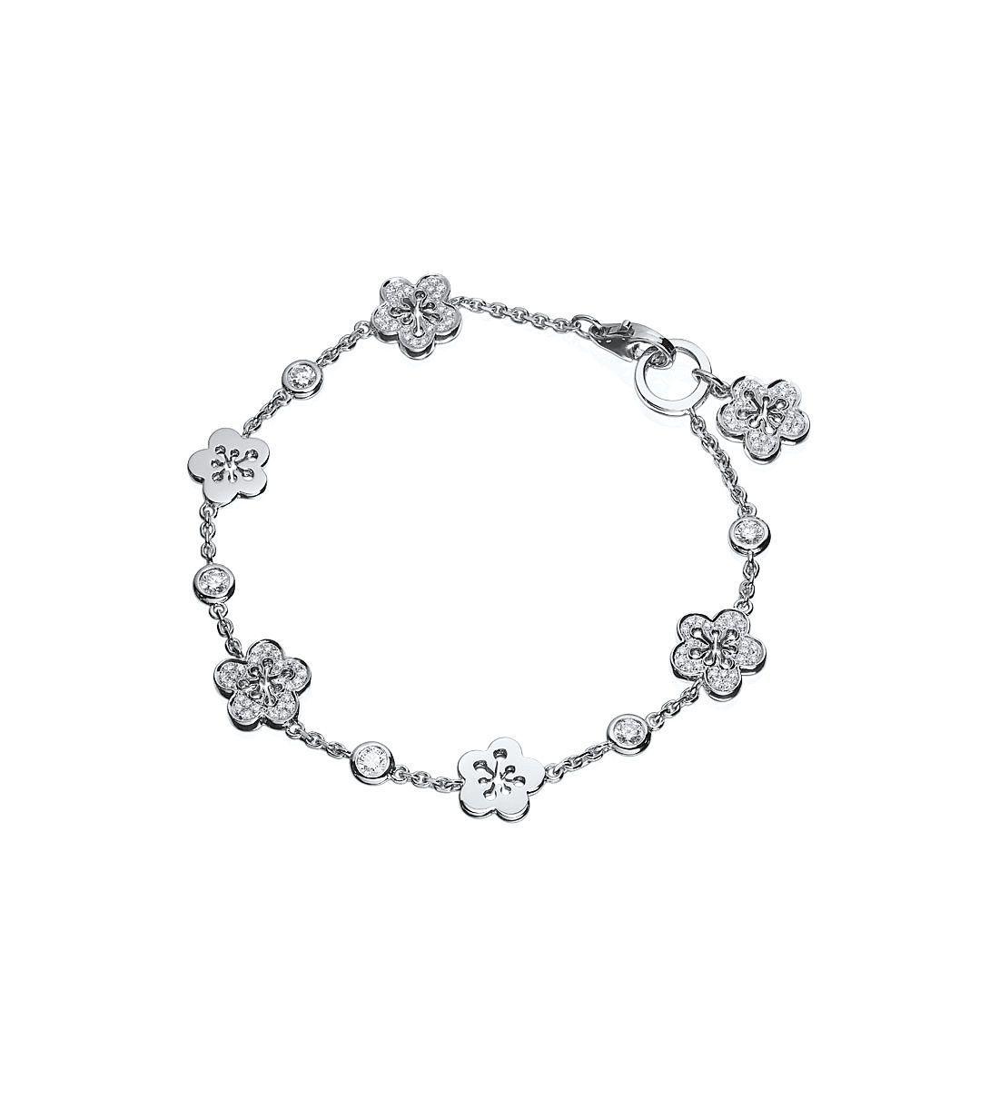 A charming white gold diamond charm bracelet from boodlesu blossom