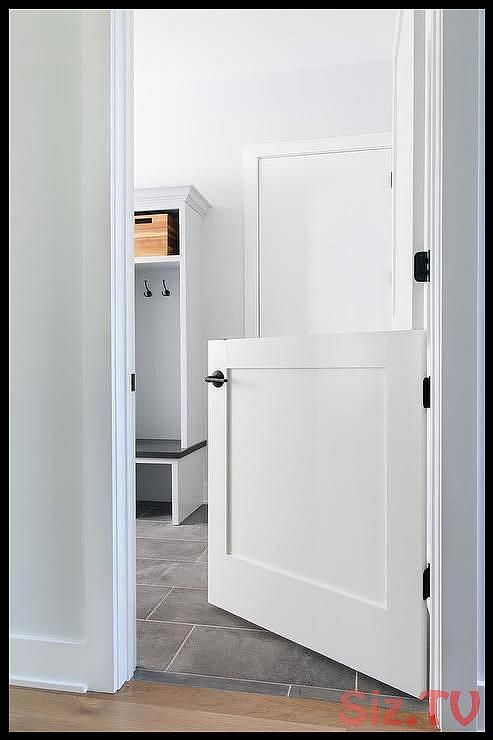 A white dutch door contrasted with oil rubbed bronze hardware opens to a white and gray laundry room and mudroom combo graylaundryrooms A white dutcA white dutch door con...