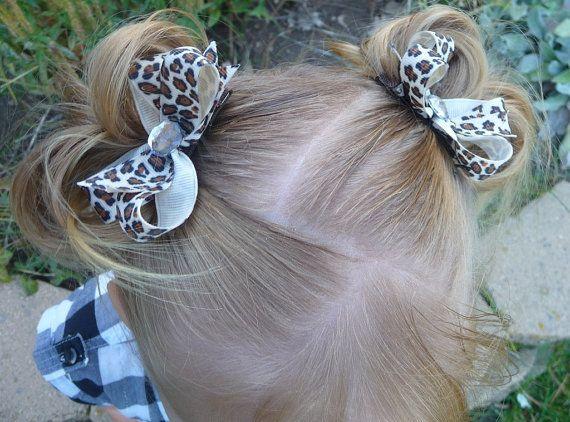 Leopard print pigtail bows.