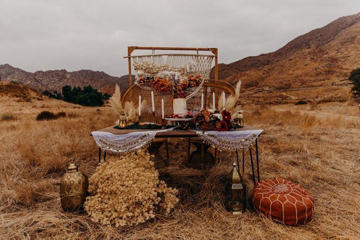 You're Gonna Wanna Copy The Rich Color Palette in This Desert Elopement Inspiration at Sycamore Canyon Trails #colorpalettecopies We can feel the cozy fall tones from this desert wedding inspo | Image by Melissa Rey Photo  #wedding #weddinginspriation #desertwedding #fallwedding #earthywedding #bohowedding #bohemianwedding #reception #sweethearttable #weddingreception #tabledecor #weddingdecor #colorpalettecopies