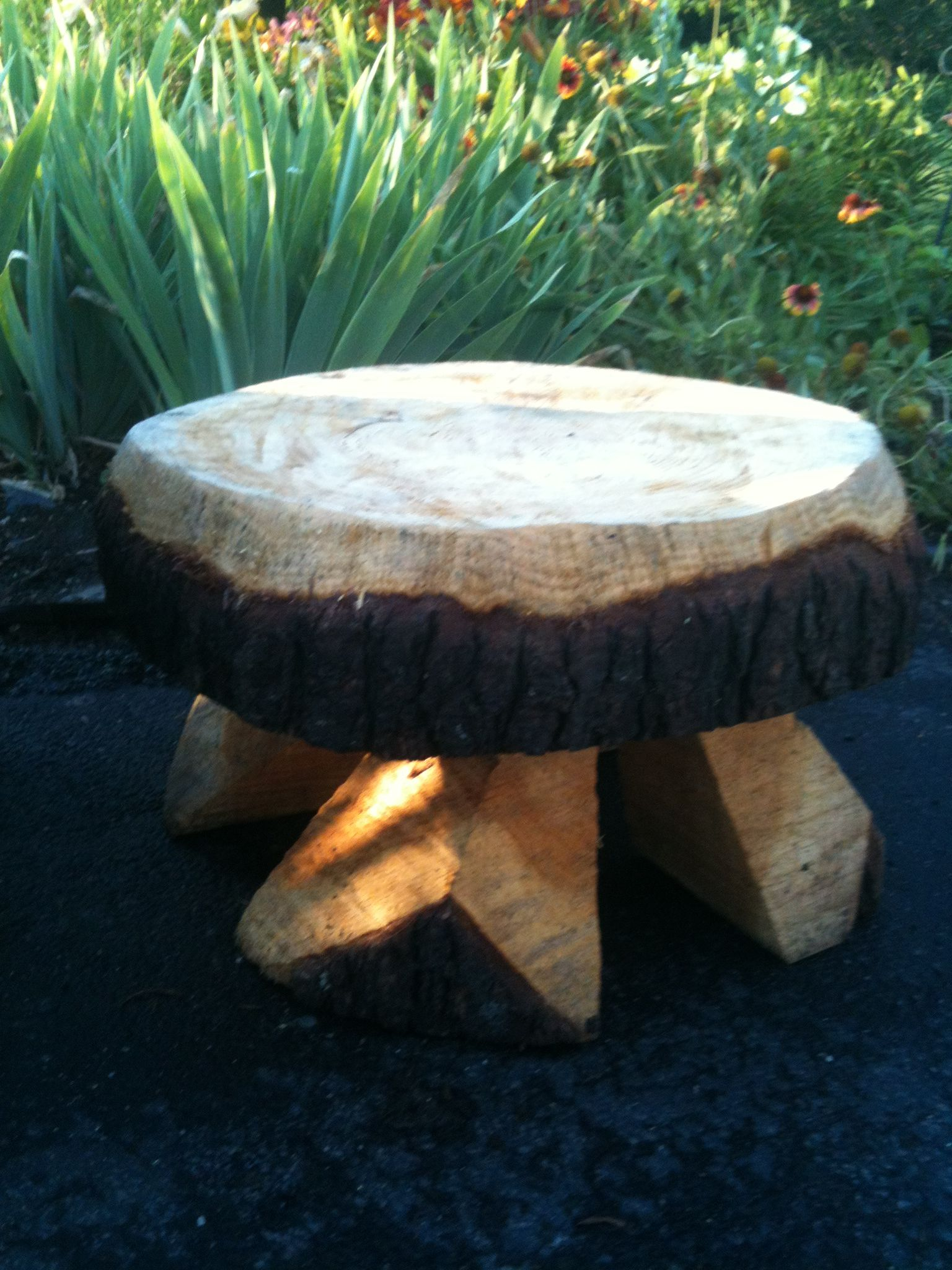 This bench was made from a slice of a tree trunk and legs for Large tree trunk slices