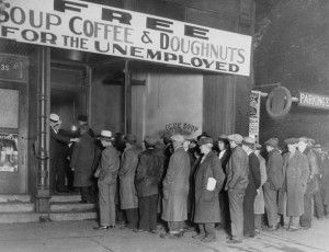 """16 Nov 1930, Chicago, Illinois, USA --- Notorious gangster Al Capone attempts to help unemployed men with his soup kitchen """"Big Al's Kitchen for the Needy."""" The kitchen provides three meals a day consisting of soup with meat, bread, coffee, and doughnuts, feeding about 3500 people daily at a cost of $300 per day. --- Image by © Bettmann/CORBIS"""