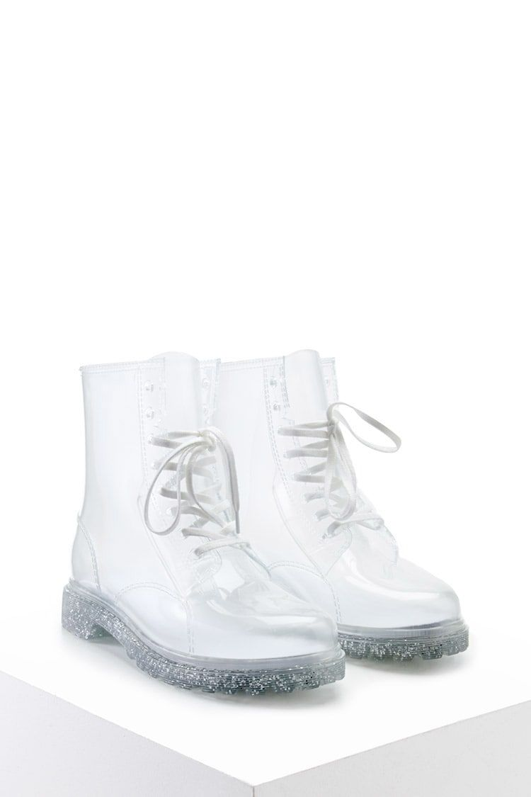 A pair of ankle boots in a water