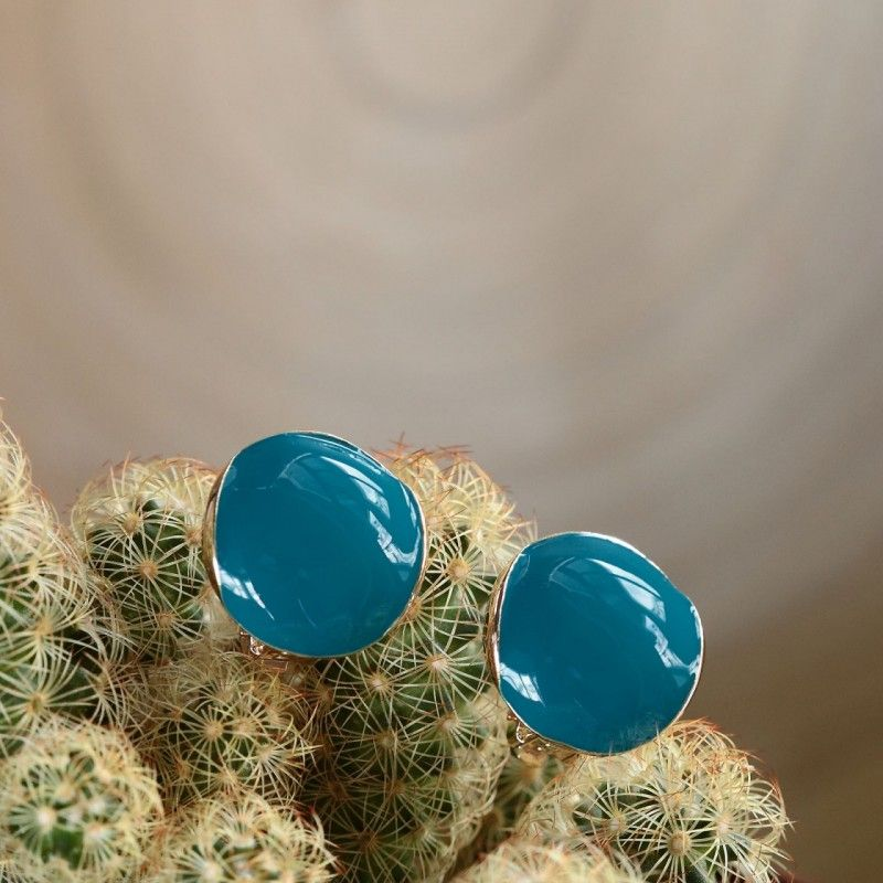 $4.95  Blue Round Clip Earrings  This cute round enamel clip earring features its simple round shape design and cabochon like enameled surface. It's surely a top chice to wear it from day to night.
