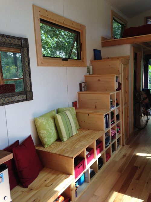 The highest steps are tall enough to hang clothes and the lower steps are drawers. - Radhause Tiny House Stairs | Simply Marie Tiny House Blog #tinyhousestorage