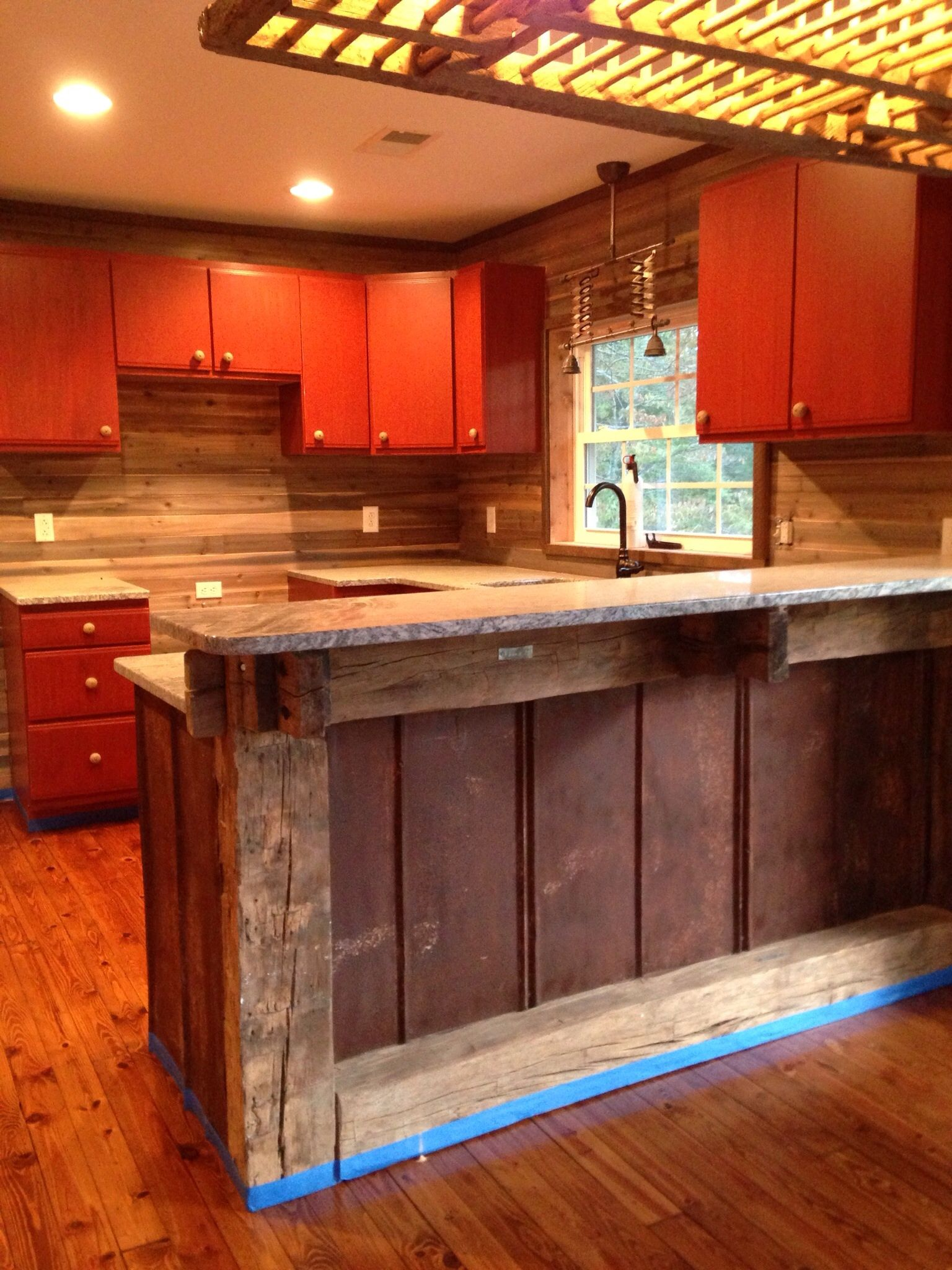 Ordinaire Kitchen Bar Supports Made From Old Numbered Beams And Back Splash Is  Reclaimed Rusted Metal Roofing