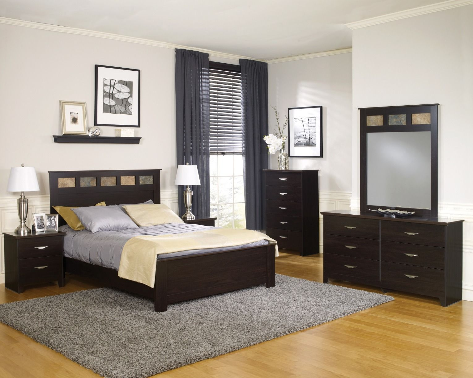 Showcase your style and taste with this trendy Dakota™ Queen Bedroom Suite. Available in a lavish Espresso Finish, this beautiful bedroom set delivers elegant and functional furnishings for your home!