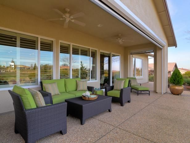 Bright Green Cushions Liven Up A Dark Wicker Patio Furniture Set The Covered And Ceiling Fans Ensure Private Relaxing Comfortable Outdoor