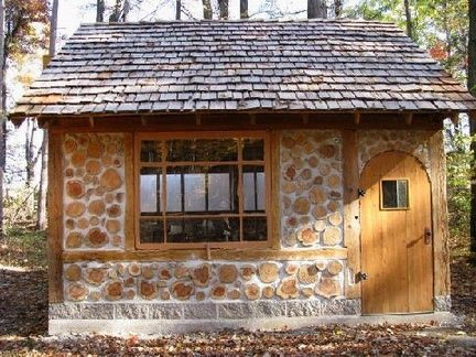 cordwood, a natural building technique that resembles stone from