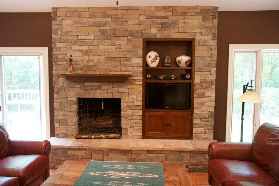 attractive home interior design using stone fireplace wall panels