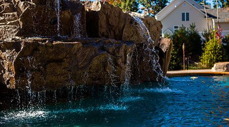 Backyard Water Features, Pond Waterfalls, & Swimming Pool Waterfalls in Evansville, IN, Paducah, KY and Marion, IL.