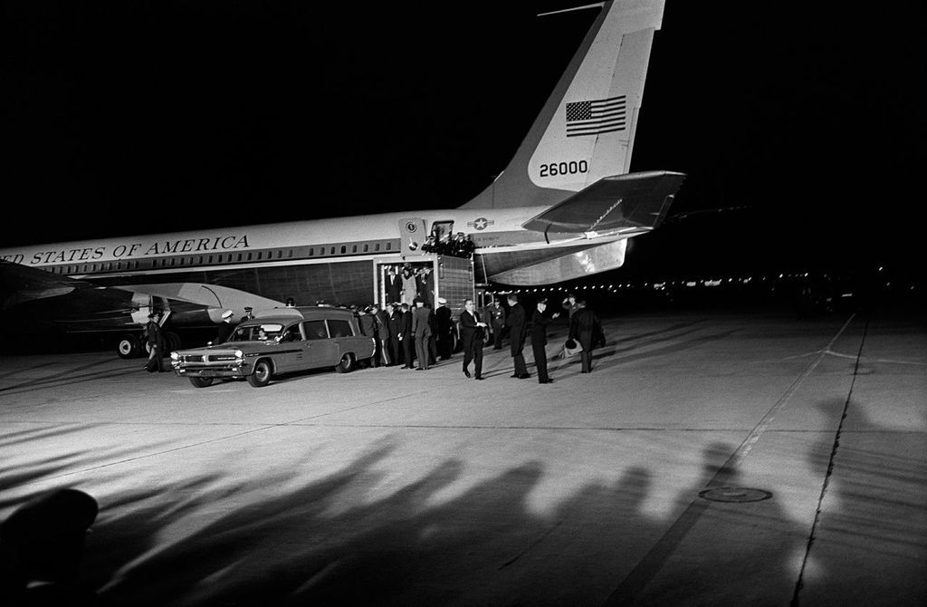 At Andrews Air Force Base, President Kennedy's body is returned from Dallas and unloaded from Air Force One into a Navy Ambulance. 1963.