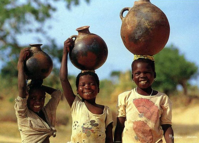 Africa | Smiling water carriers.  Cameroon || Scanned postcard