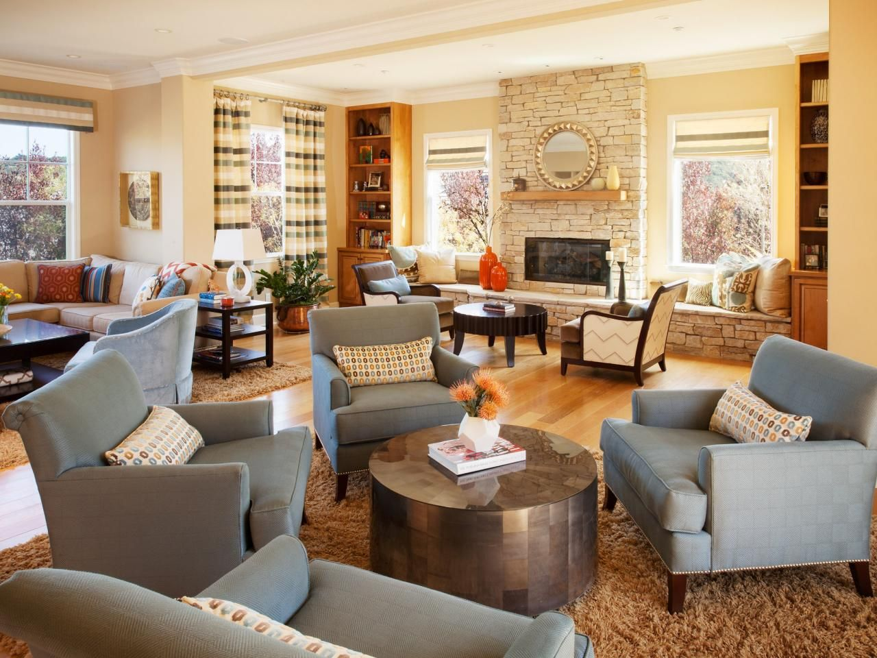 This Spacious Living Room Is Divided Into Several Sitting Areas Including One Anchored By A