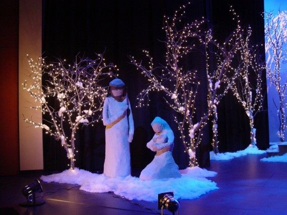 trees made with branches to decorate the church backdrop church stage design christmas stage design