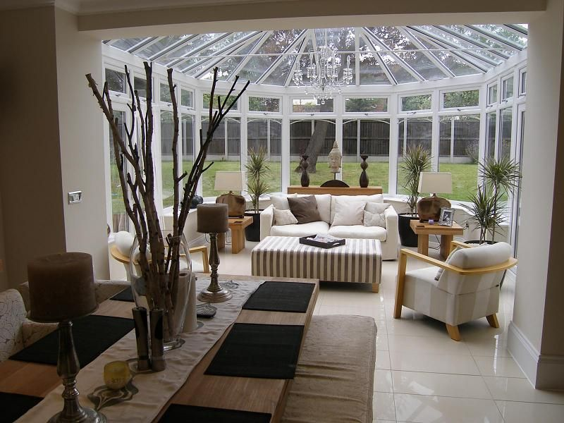 Photo Of Contemporary Homely Open Plan Traditional Brown White Conservatory Living Room With Flooring