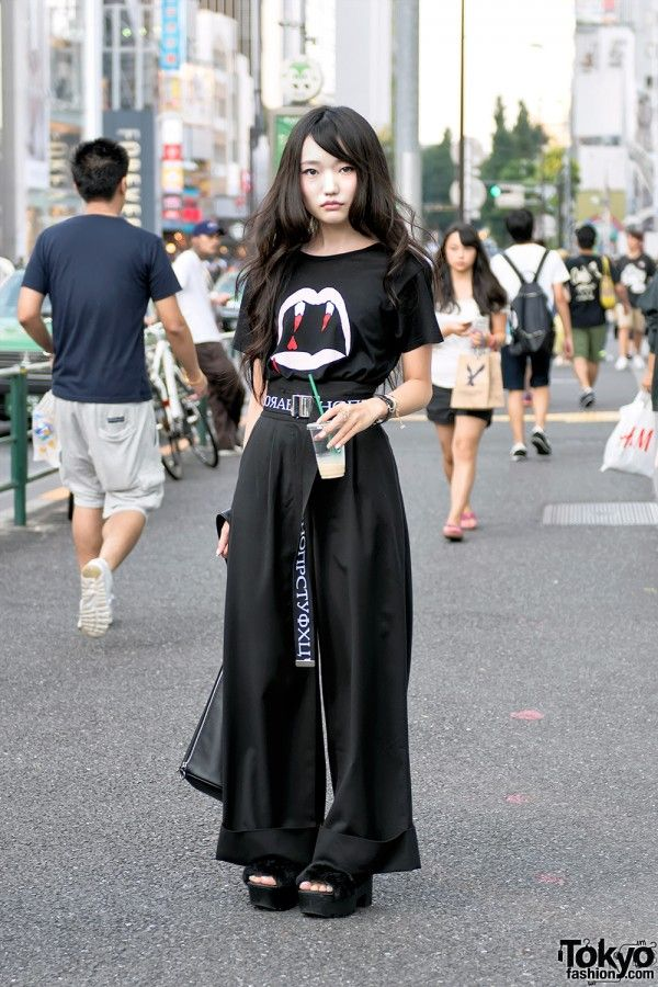 Haruka's look features a Saint Laurent vampire fangs t-shirt over Emoda high-waist wide leg pants and Pameo Pose furry platform sandals. Accessories include a tied belt from the Japanese brand G.V.G.V., a Maison Martin Margiela bracelet, Hermes watch, and vintage leather handbag.