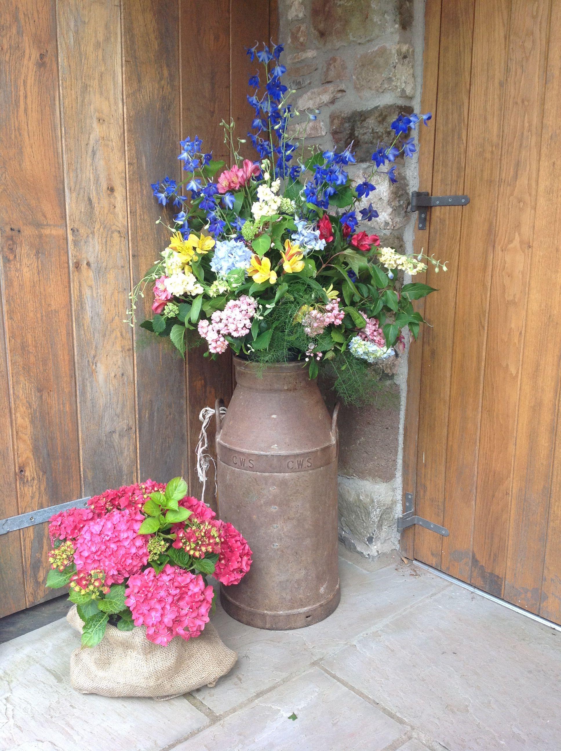 Milk churn flower arrangement for a wedding (With images
