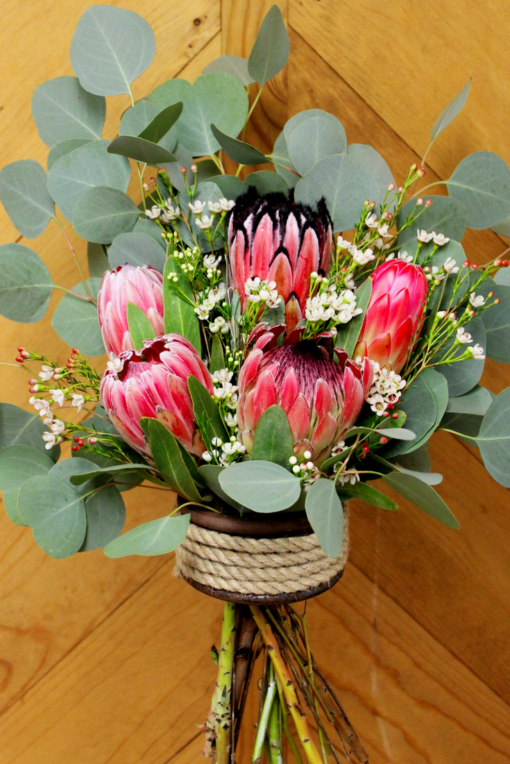 Protea Alone Is An Eye Grabber This Perfect Protea Bunch Is Sure To Be Your Favorite Protea Flower Flowers Protea Bouquet Protea Flower Protea Centerpiece