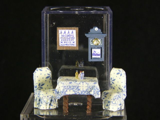 Album: Table, two chairs, clock, and sampler $36.