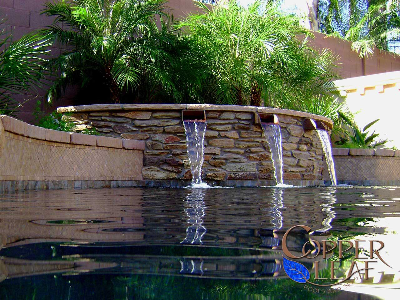 Resort style pool water feature with copper scuppers for Pool design features