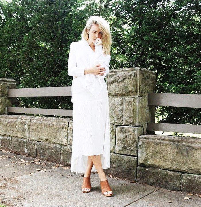 Brooke Testoni wearing a white skirt, white sweater, and tan mules // Photo: Brooke Testoni