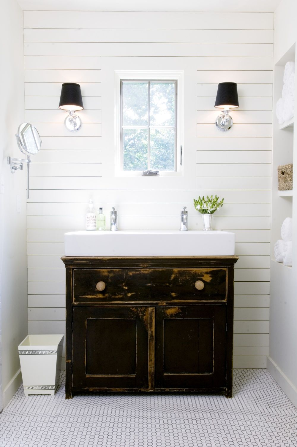 Plank walls in bathroom - Farmhouse Bathroom With White Plank Wall And Distressed Black Vanity Designed By David Anderson Architect