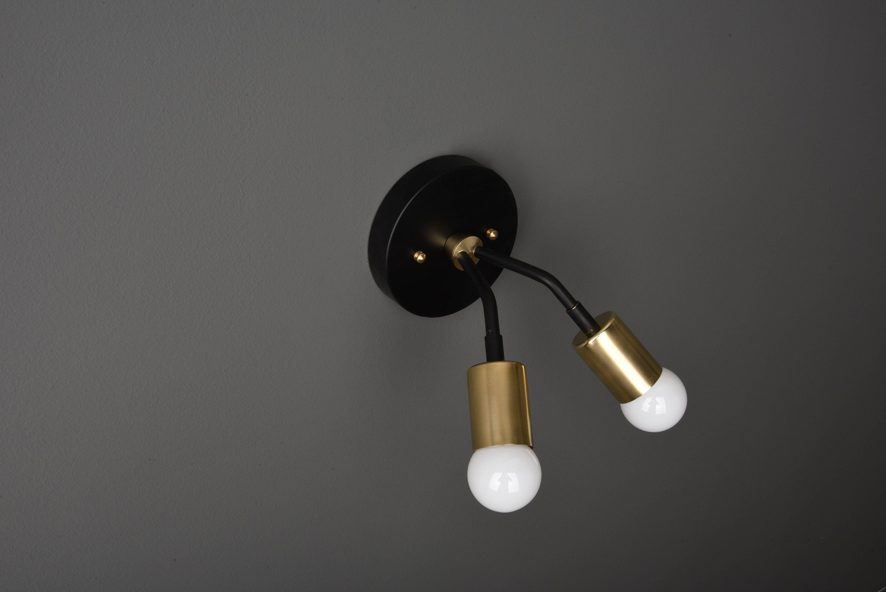 Stunning 2 Bulb Wall Sconce With Angled Arms Can Be Installed With The Bulbs Pointing Up Or Down Finishes Avail Modern Wall Lights Wall Lights Black And Brass