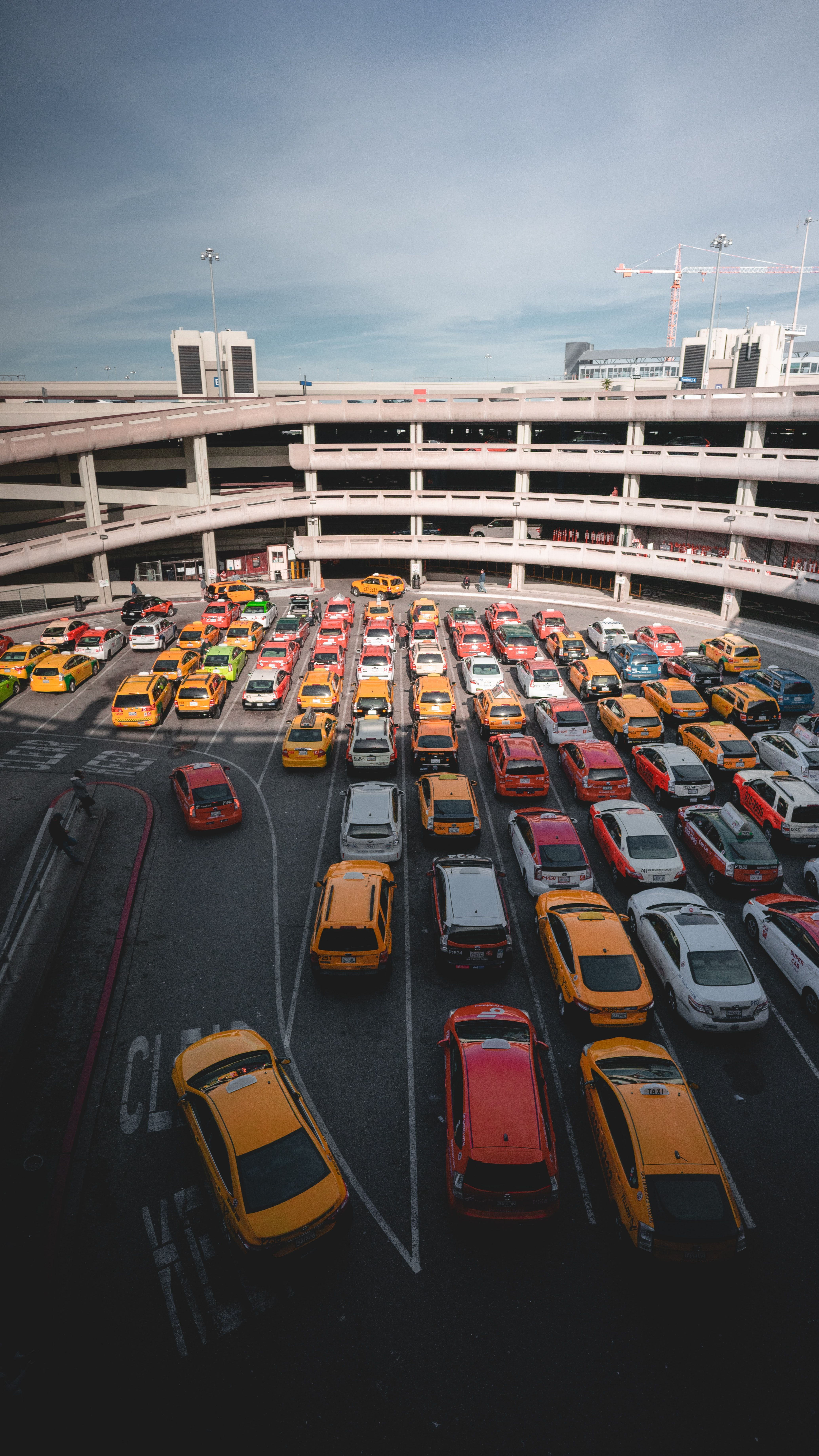 Different cars parking near white buildings in 2020 (With