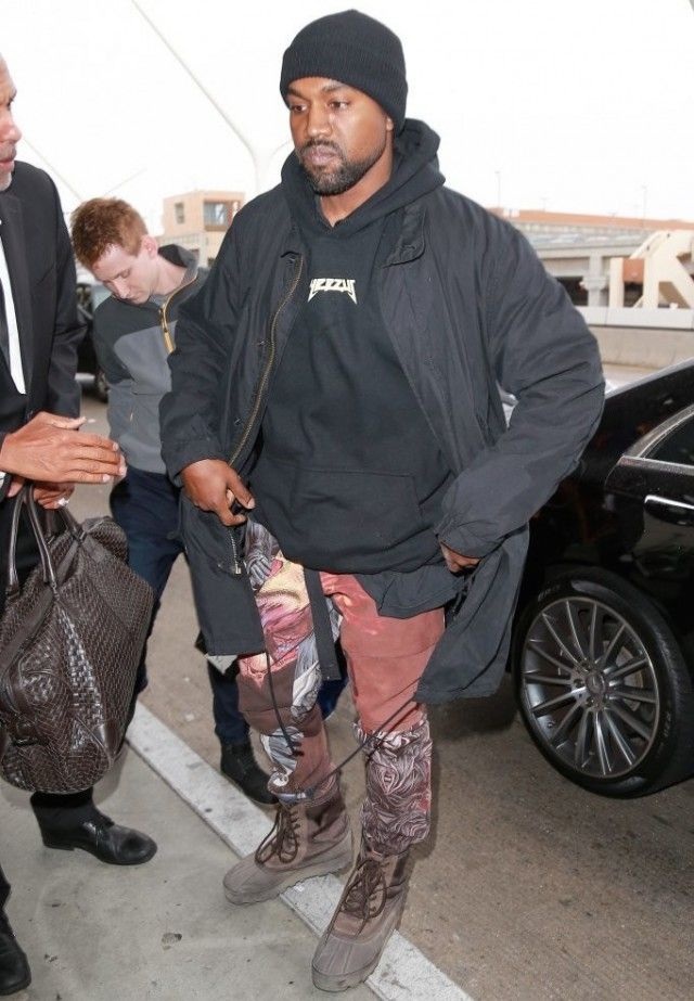 Kanye West Spotted At LAX Wearing