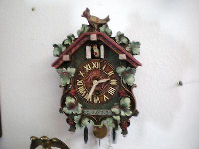 A vintage bobbing bird cuckoo clock marked on the back Lux Clock Mfg. Co., Waterbury, Conn.. The clock worked good at least 24 hours. Described in  Don and Alice Nicholson's book Novelty and Animated