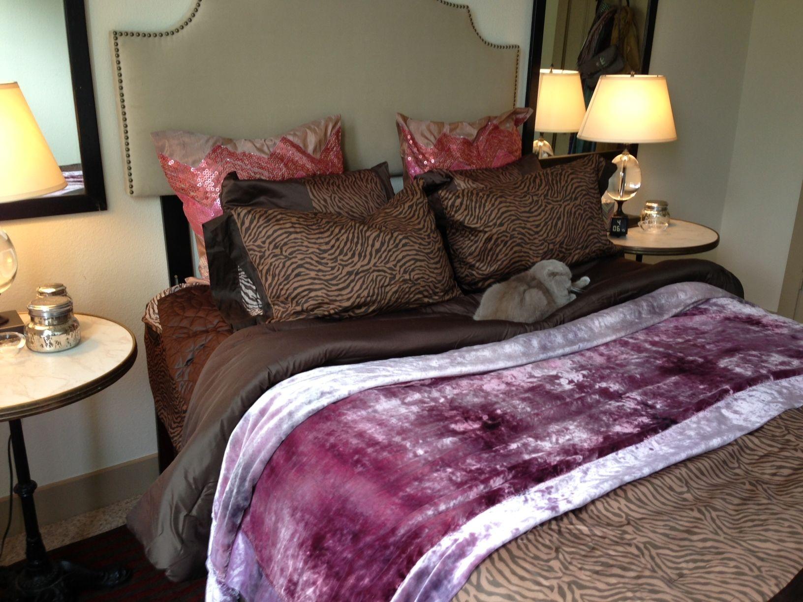 Added sequin chevron pillows to bedding to lighten up dark bedding.