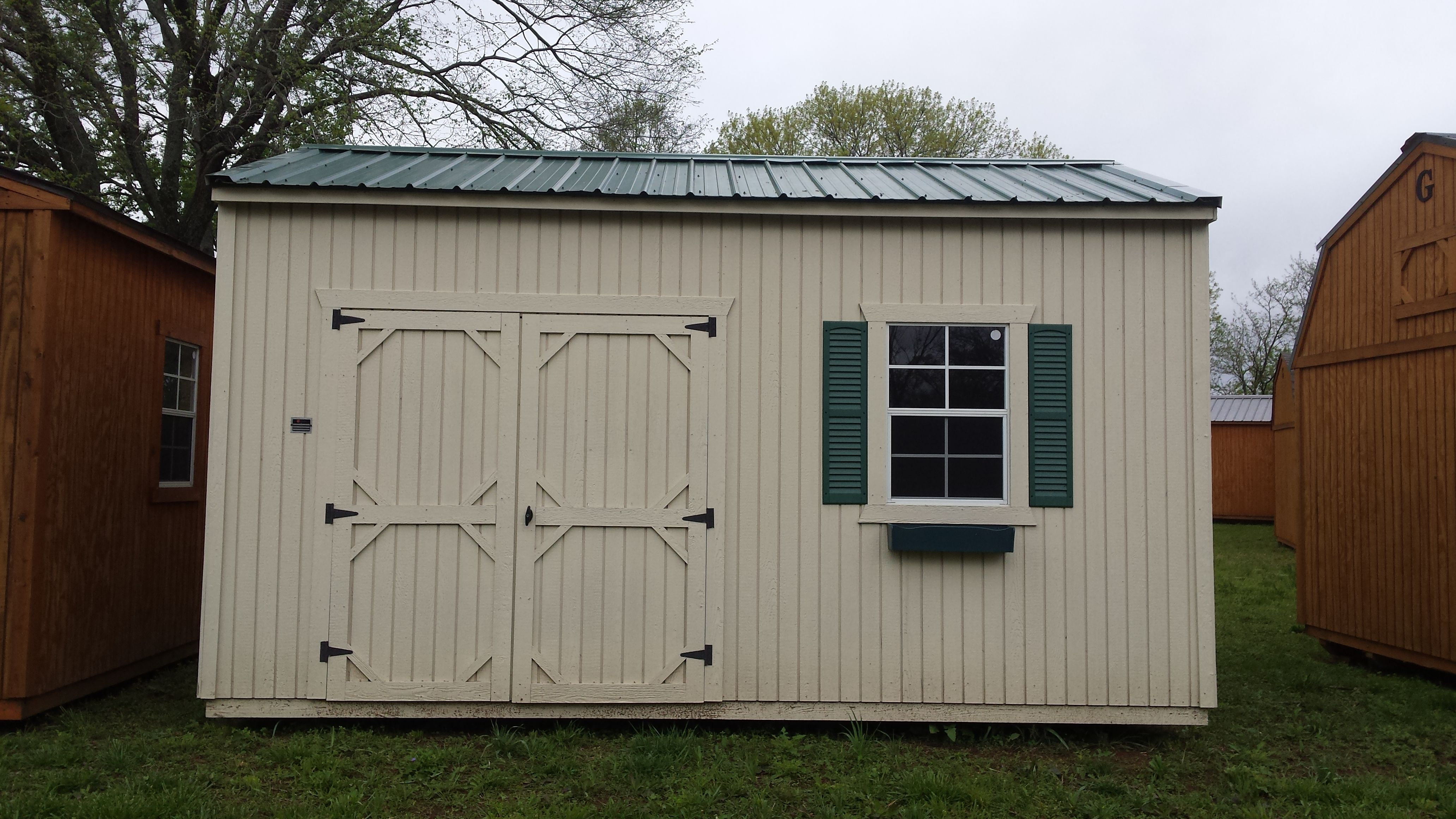 Our Garden Shed In Navajo White With Green Shutters And A Green Flower Box Awesome Colors See Your Local Representativ Portable Buildings Green Shutters Shed