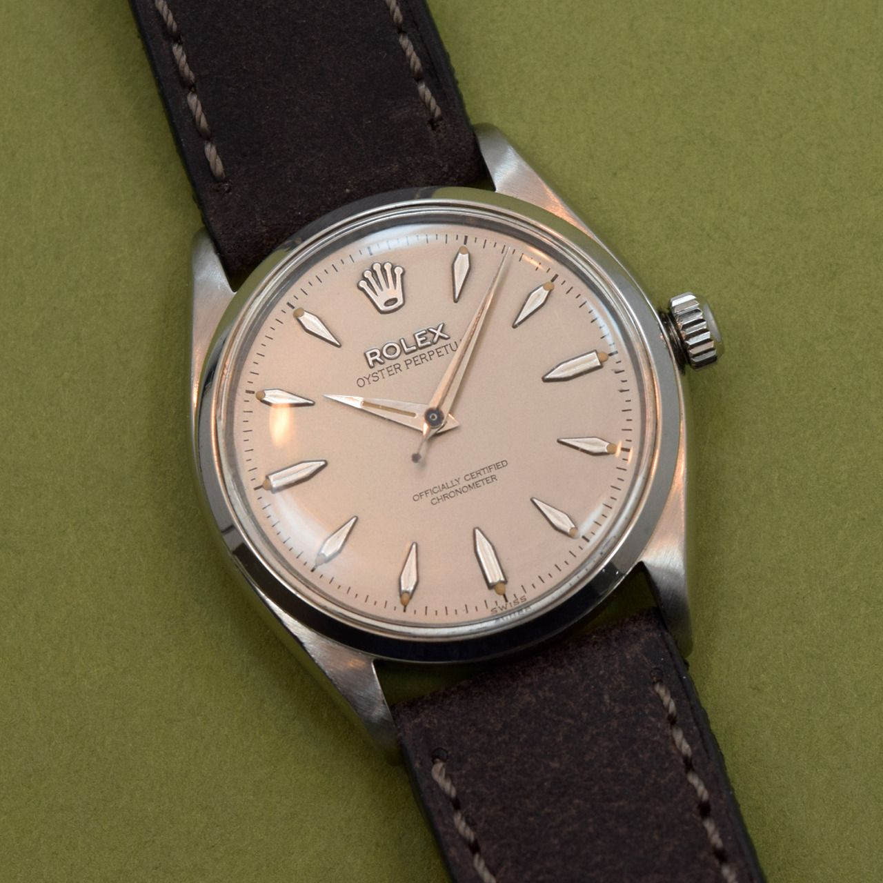 """A 1958 vintage Rolex Oyster Perpetual Reference 6564 that comes equipped with a stainless steel case, a silver/gray dial with applied steel, arrow markers, and a 25-jewel, caliber 1030 automatic movement. This example features a 19mm, Dark Chocolate """"Rough-out"""" Leather watch strap. (Store Inventory # 10110, listed at $3100). #rolex #oyster #perpetual #style #dapper #silver #steel #mens #wristwatch #watches #classic #timepieces #watch #stawc"""