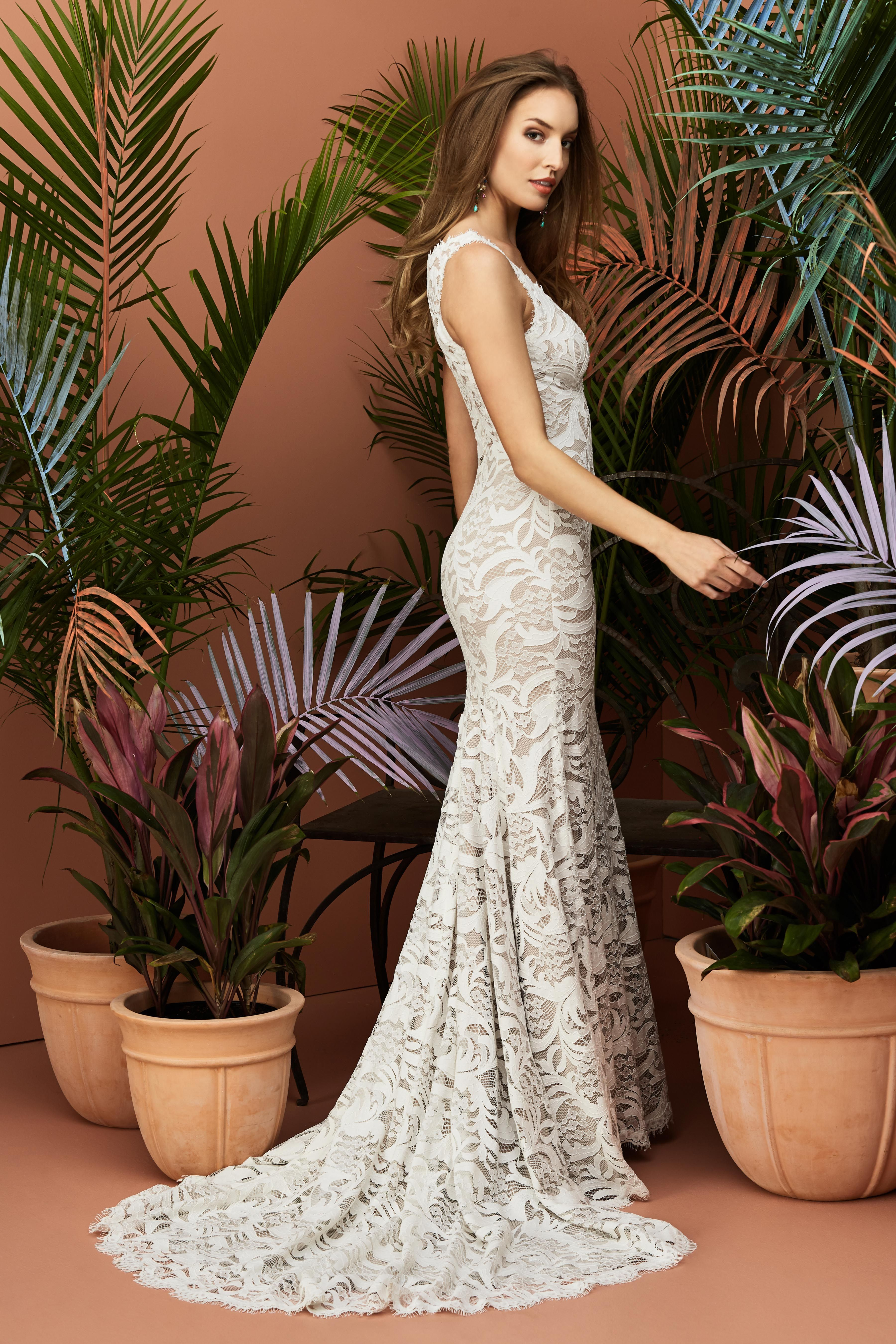 This gorgeous fitandflare wedding dress features a stylish vneck