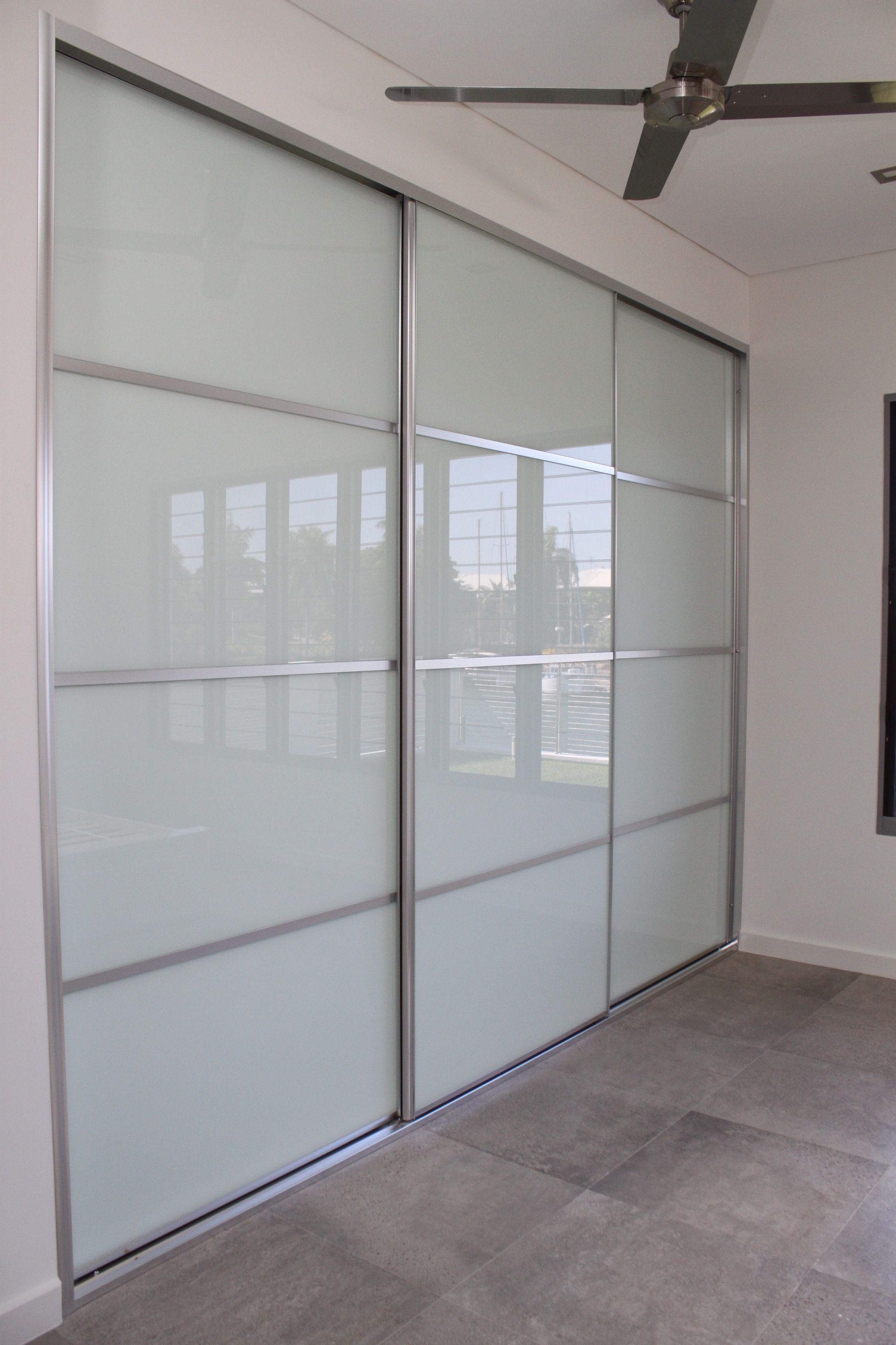 Four Panel Sliding Doors Using White Glass Bright Silver Frames