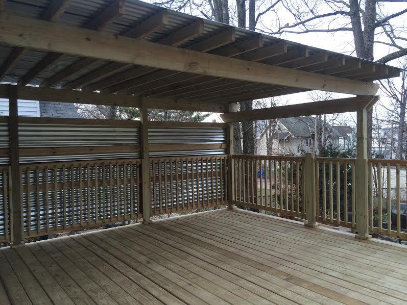 Pressured Treated Wood Deck With Corrugated Metal Privacy Wall With A Corrugated Metal Closed Pergola Built By Greate Pergola Pergola Patio Metal Pergola Diy