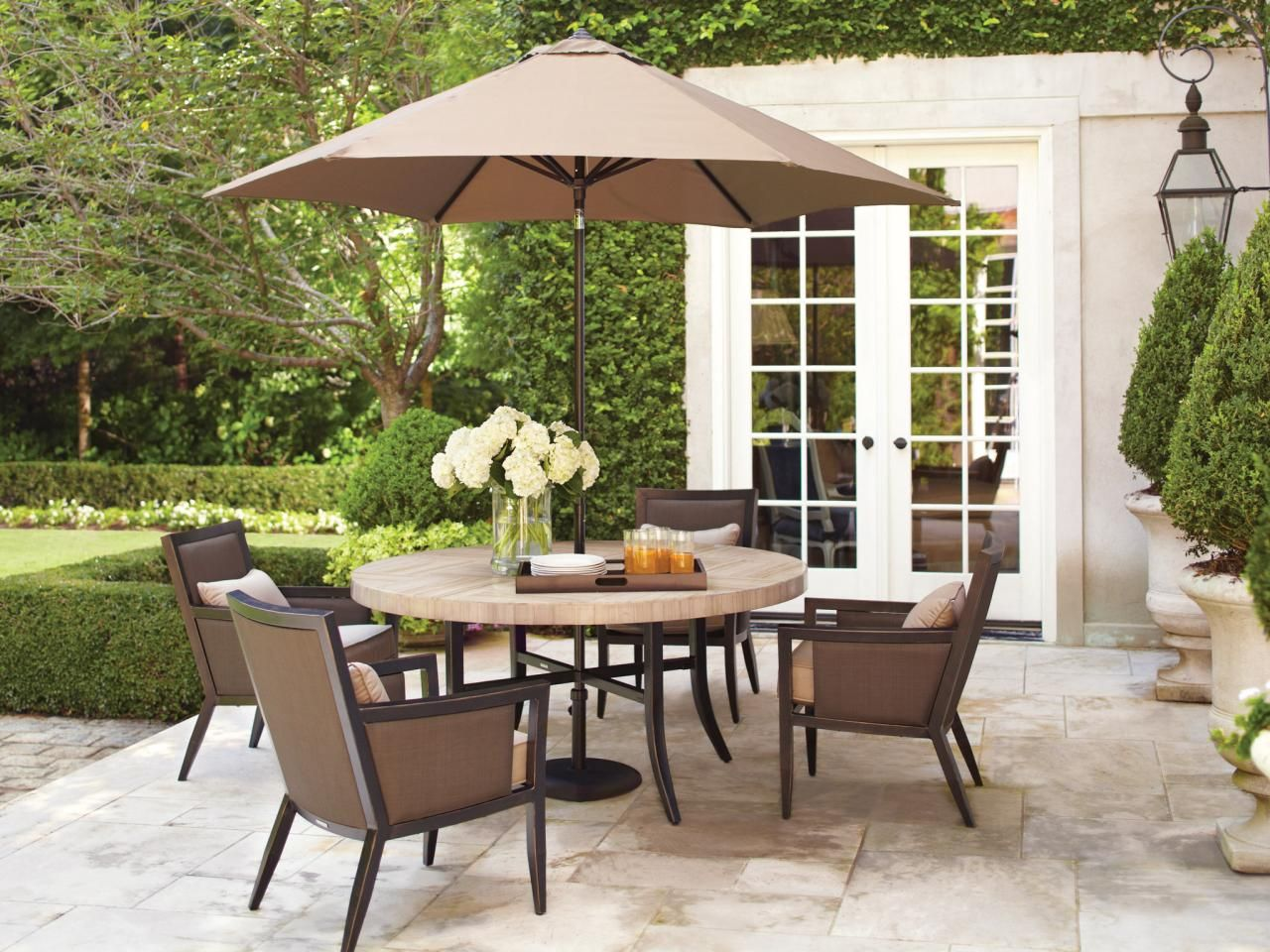 ~ Neutral colors in both outdoor furniture, floor tile and containers work in harmony in this elegant outdoor dining area ~