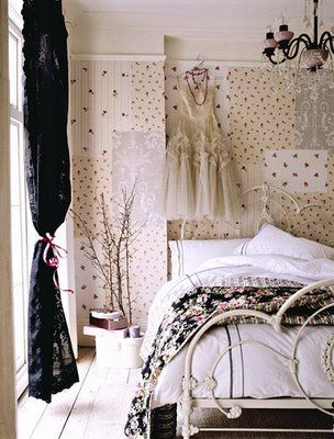 The white wrought iron bed, vintage dress, black lace curtains and black glass chandelier look beautiful together.